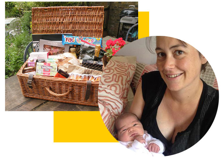 Harriet and her baby with her food hamper her friends and family contributed to through Patchwork