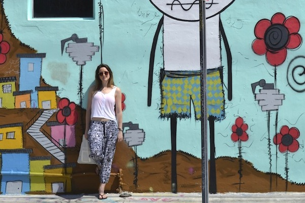 Monica Stott the travel hack leaning against painted wall - Miami