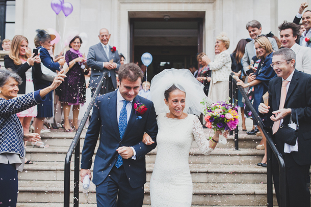 patchwork couple on wedding day coming down steps confetti being thrown