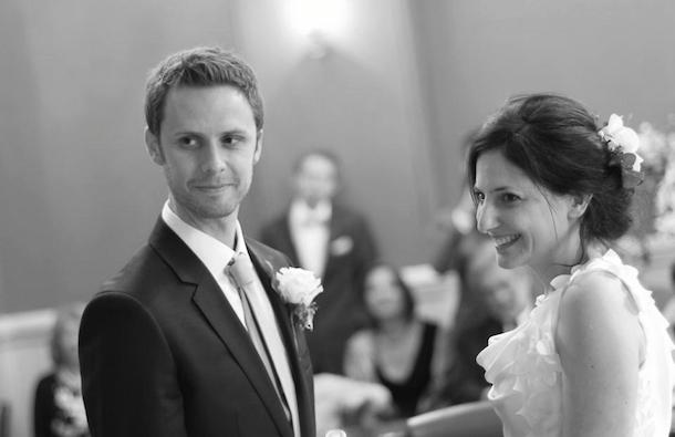 black and white image of couple making wedding vows