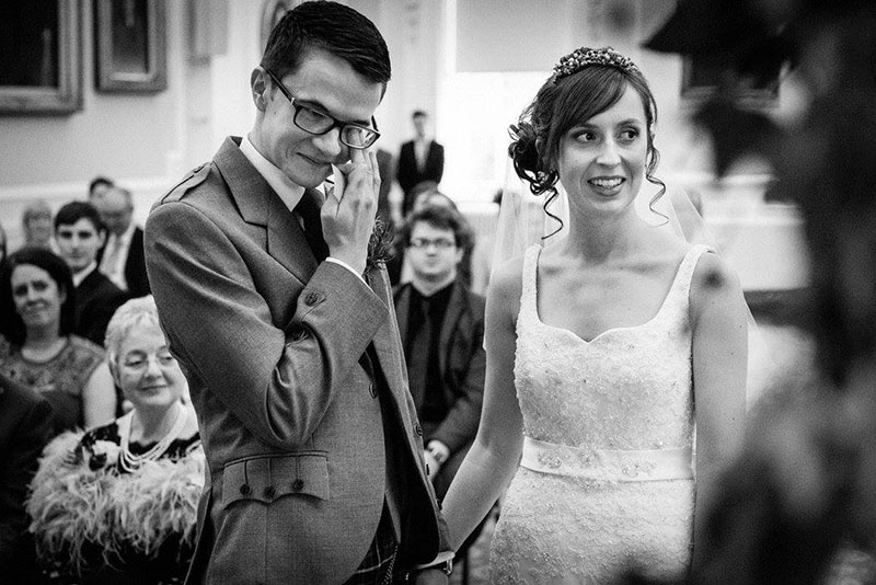 black and white photo of bride and groom on wedding day