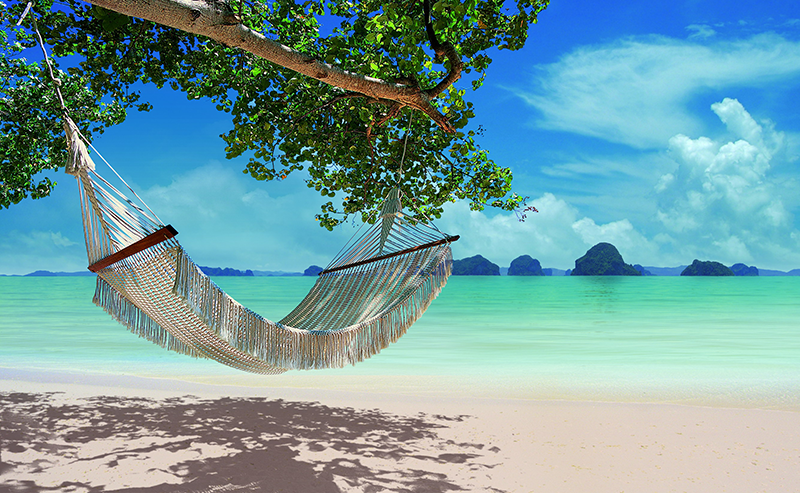hammock on white sand beach with turquoise sea