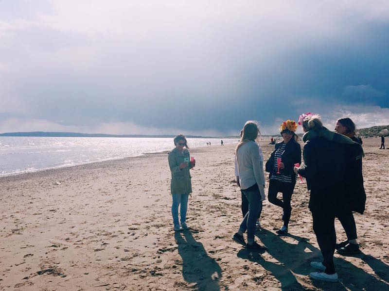 friends together on beach - wedding day stress planning