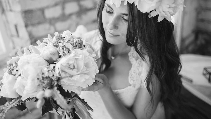 black and white close up bride with flowers