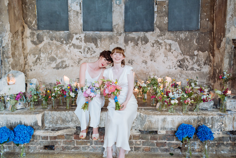 lesbian Patchwork wedding couple sitting on stone steps