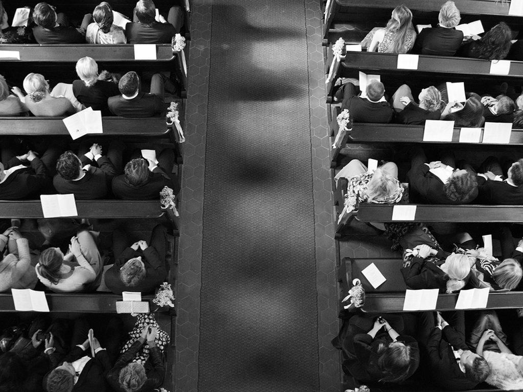 birds eye view wedding guests in church