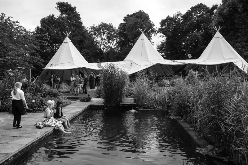 outdoor wedding day - teepees and pond