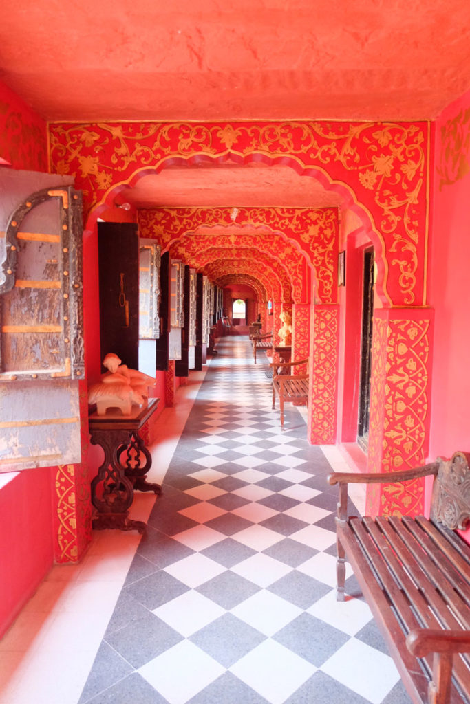 Red and gold ornately painted corridor India - career travel break
