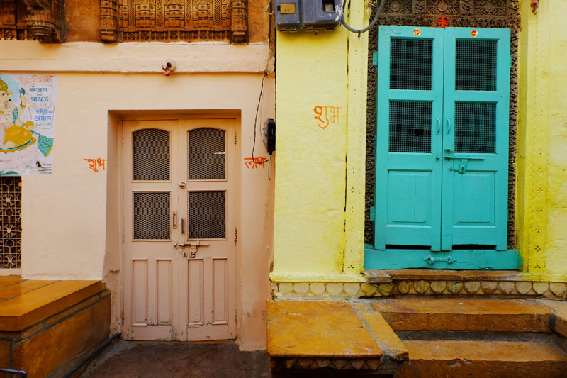 Coloured doorways in India - solo travel Patchwork