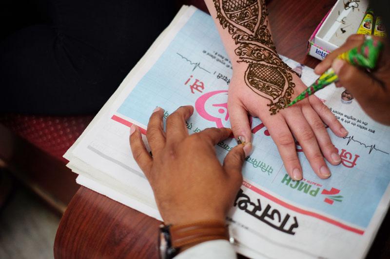 henna tattoo being done - India career break travel tips