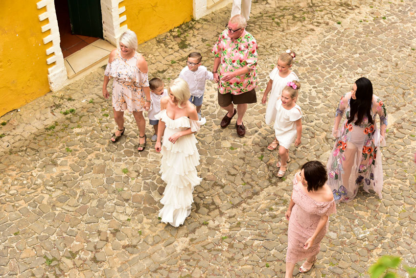 bride-on-cobbled-street-with-bridesmaids-and-flower-girls