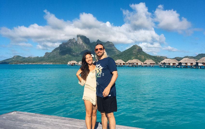 Honeymoon-couple-in-Bora-Bora-in-front-of-blue-sea