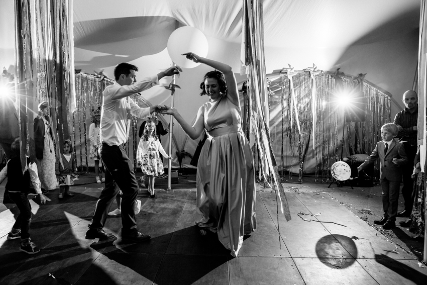 bride and groom dancing together on dancefloor