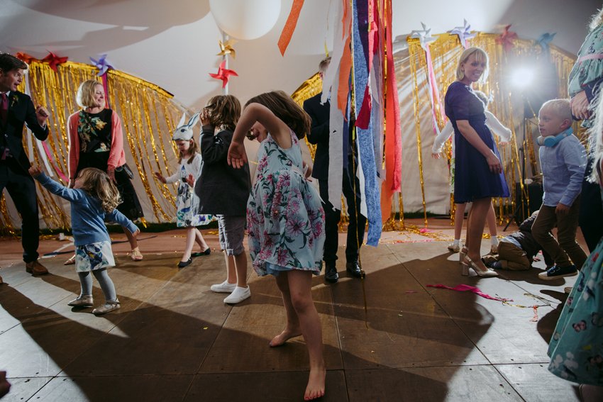 kids dancing on dancefloor with streamers