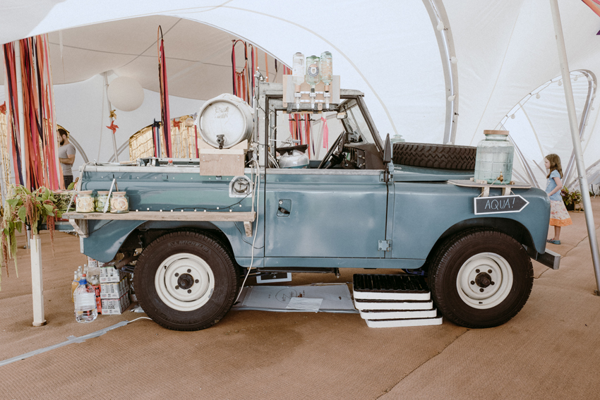 light blue land rover that has been converted in to a bar