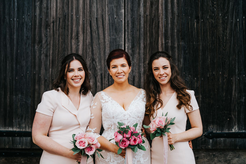 bride-and-bridesmaids-holding-bouquets-of-flowers