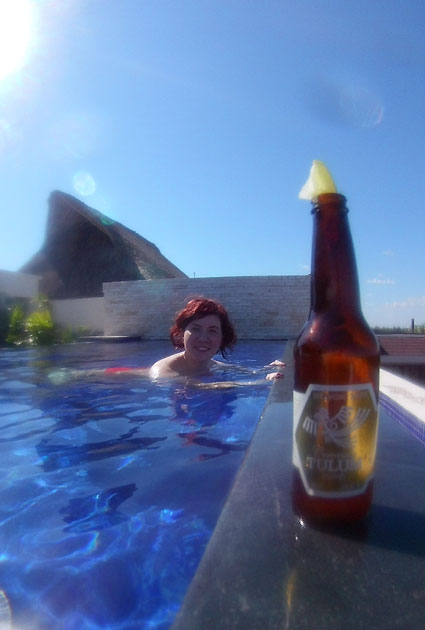 woman-in-pool-with-beer