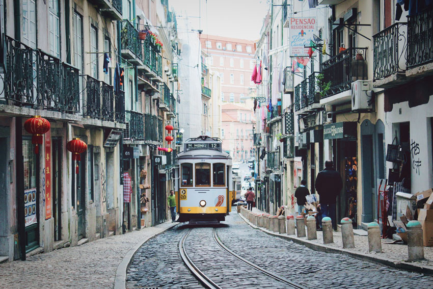 photo of lisbon street with tram