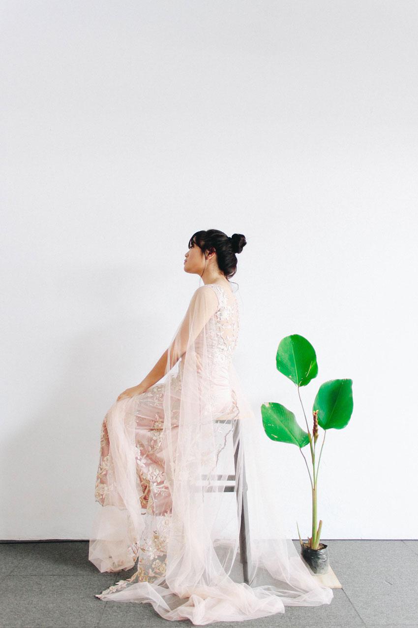 woman on stool wearing wedding dress