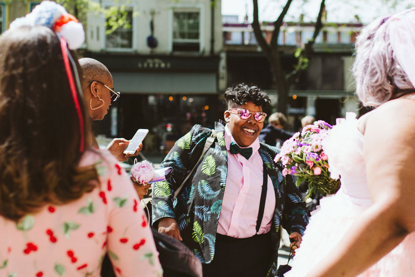lgbt-wedding-london-happy-bride-in-palm-print-suit-and-bow-tie