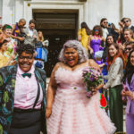 lgbt wedding london two women-and-wedding-guests-throwing-confetti