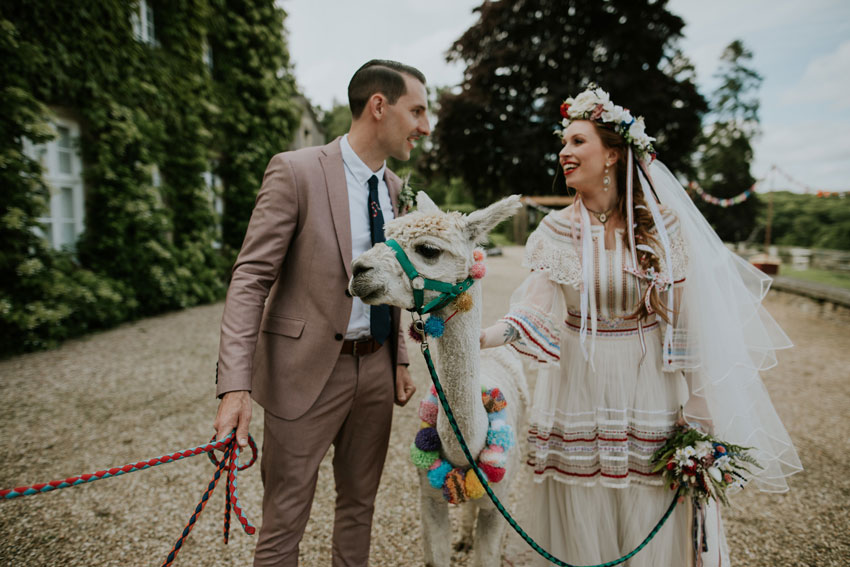 couple-wearing-wedding-outfits-with-llama-
