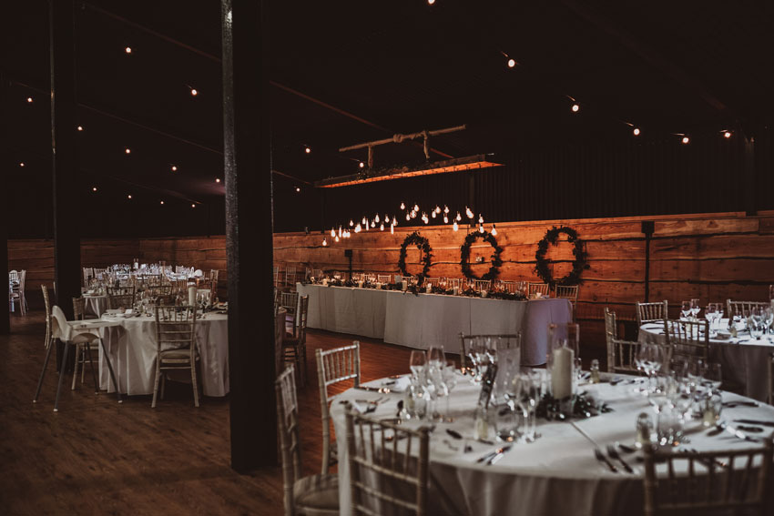 rustic barn wedding in low light
