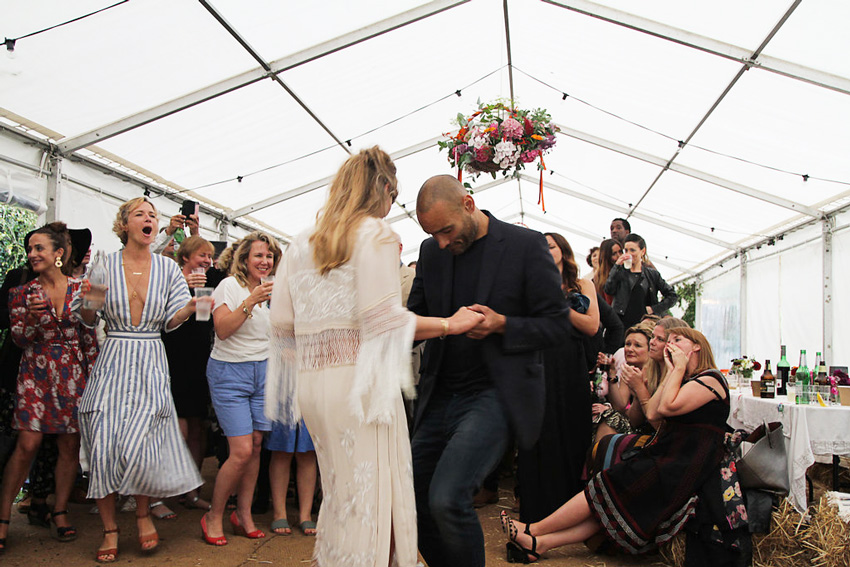 couple dancing at their crowdsourced DIY wedding
