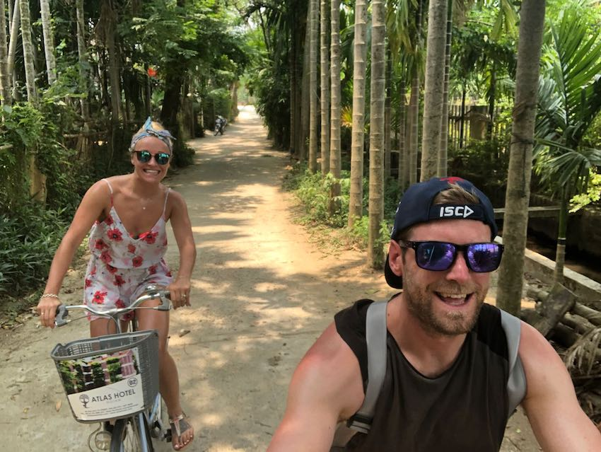 Patchwork Couple Cycling on Honeymoon Adventure