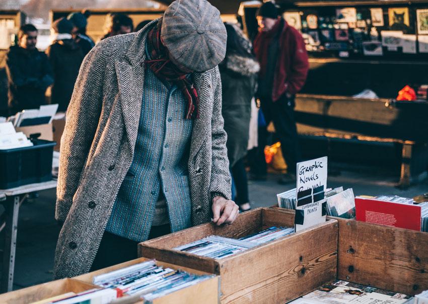 Man browsing records at a market