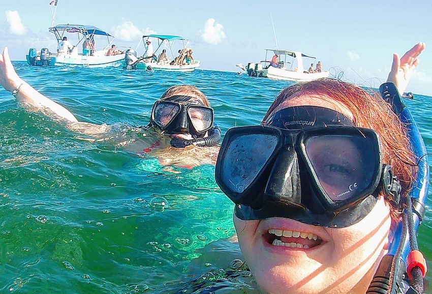 Two women snorkelling in sea in Mexico