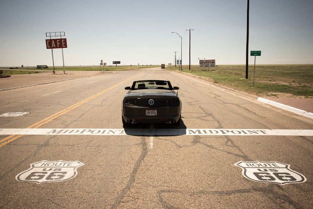 Rear view of a single car driving along Route 66