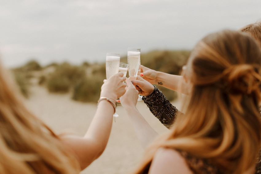 champagne toast at beach wedding