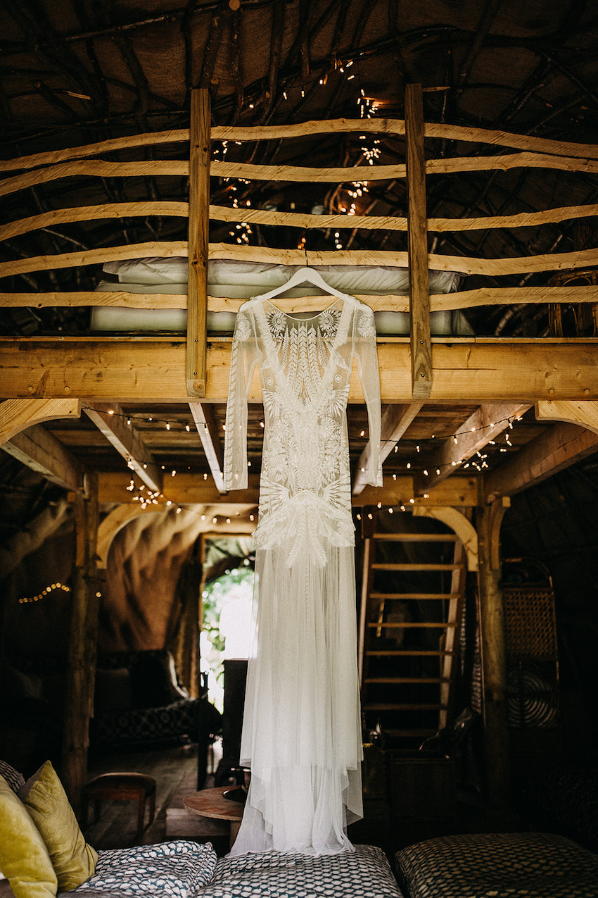 Bride's gown hanging in the Wren's Nest, at the Fire Pit Camp, Norwich