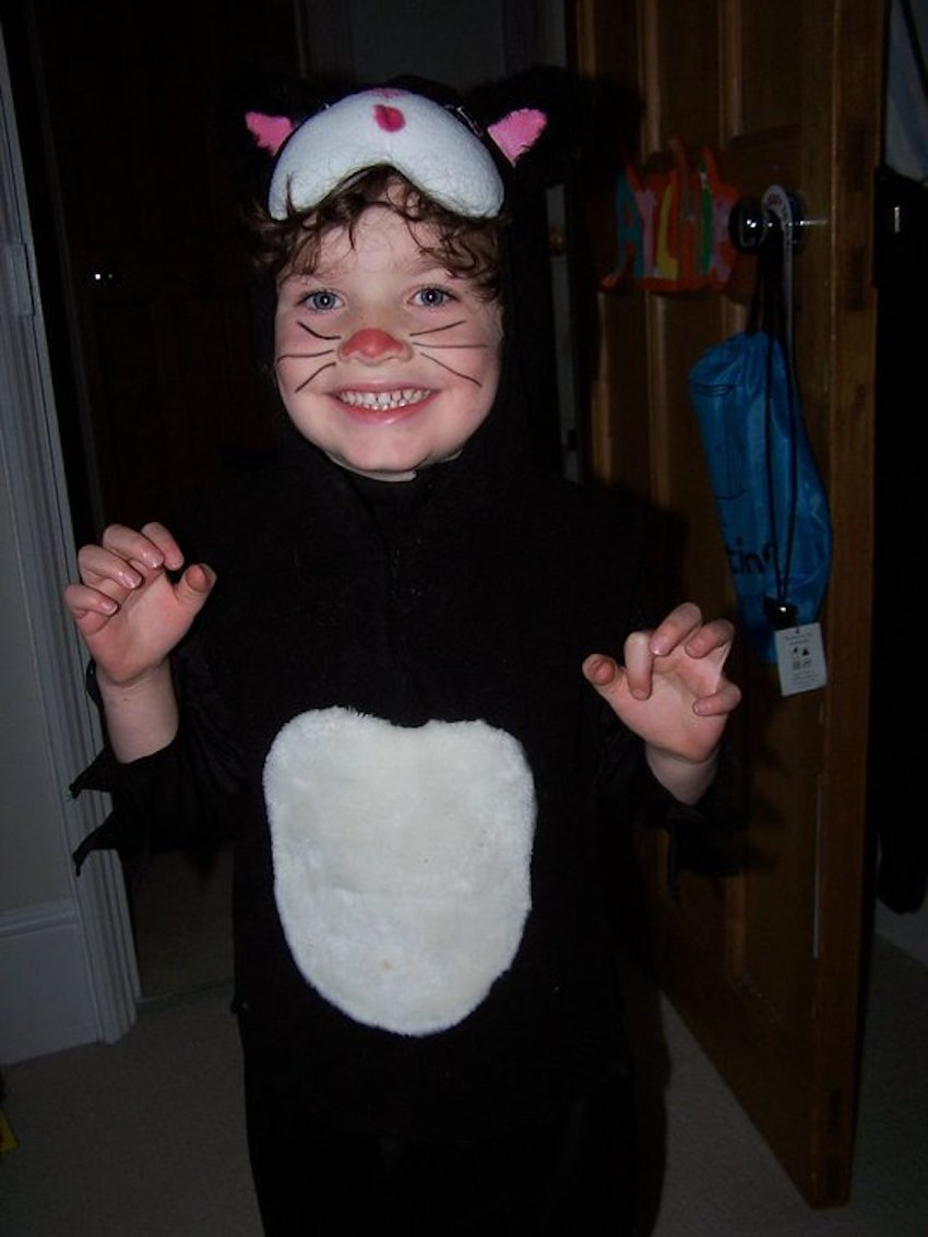Small boy in preloved Halloween cat costume