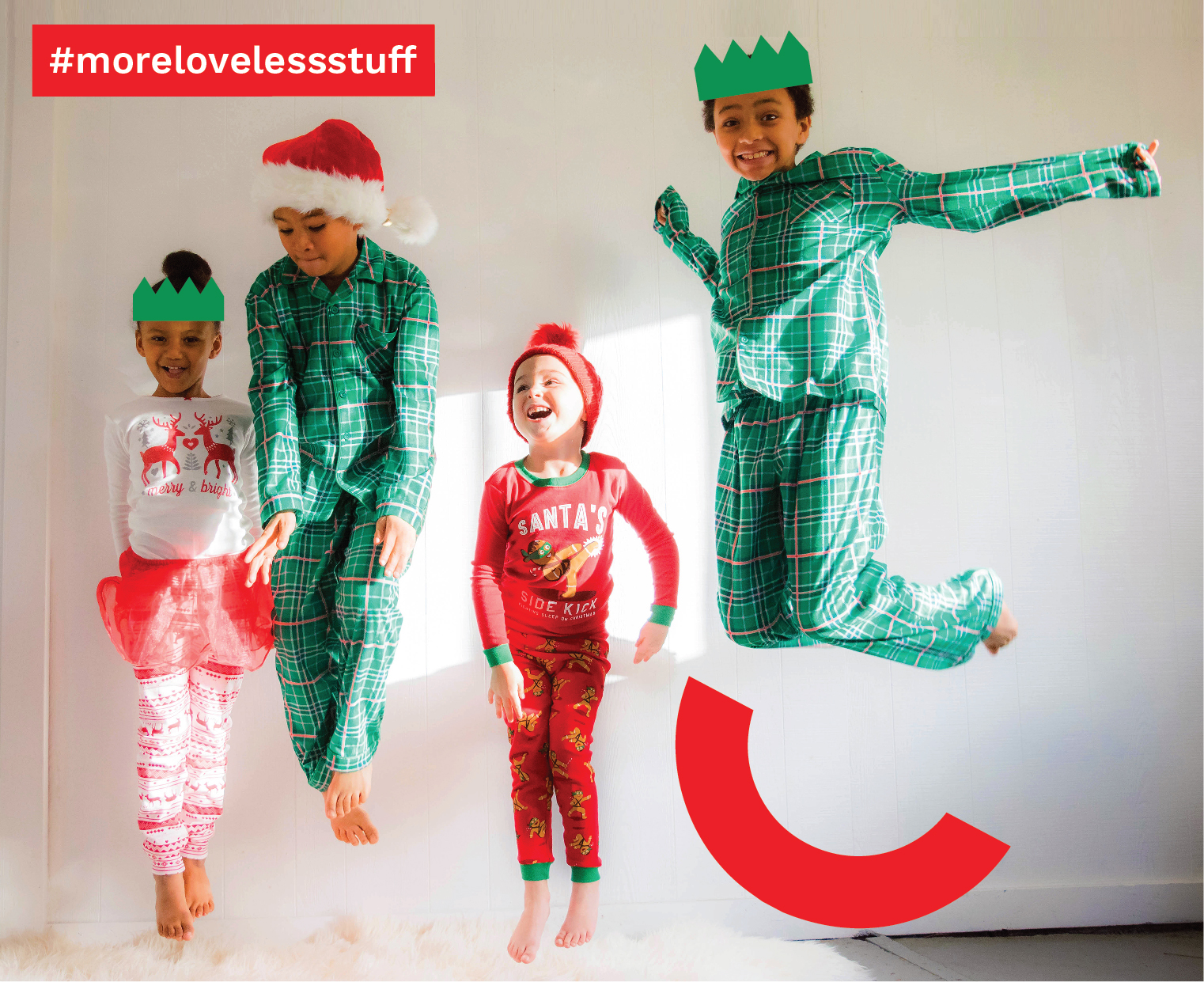 Four children dressed in Christmas outfits jumping in the air. A red box features the text #morelovelessstuff