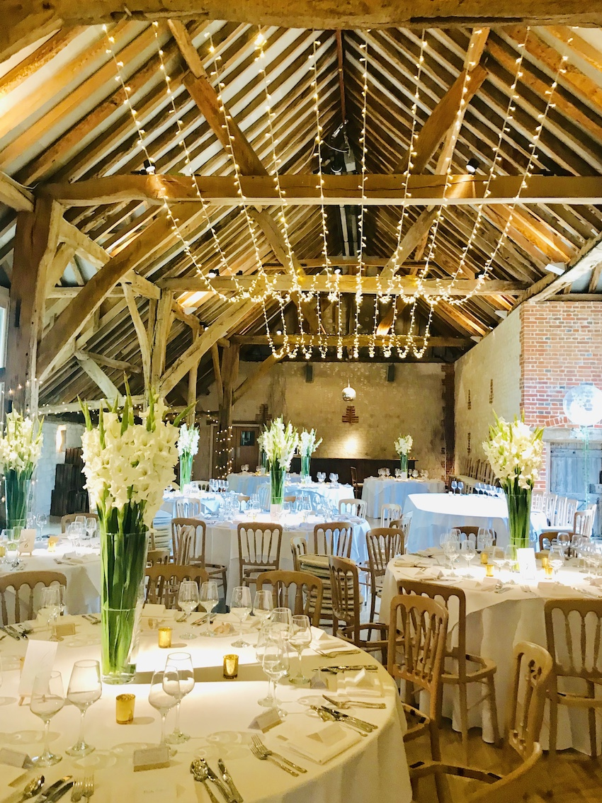 Interior of barn set up for wedding reception