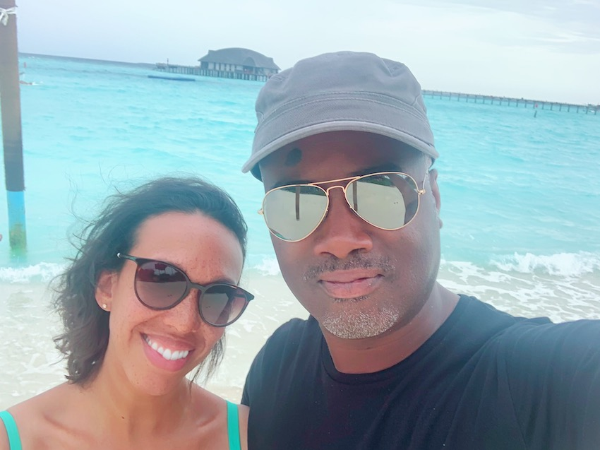 Black woman and black man selfie with turquoise sea in background