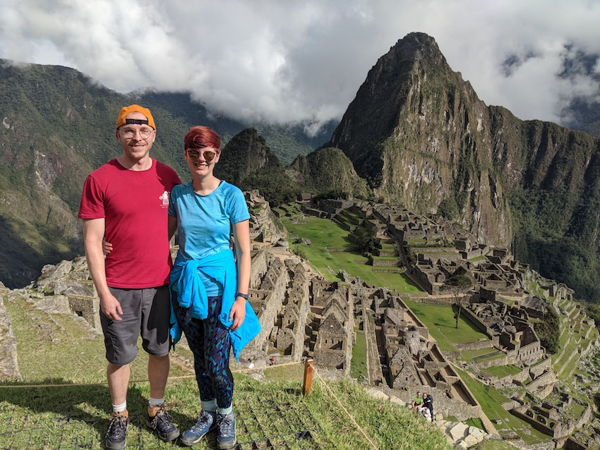 Couple standing on Inca steps Machu Picchu