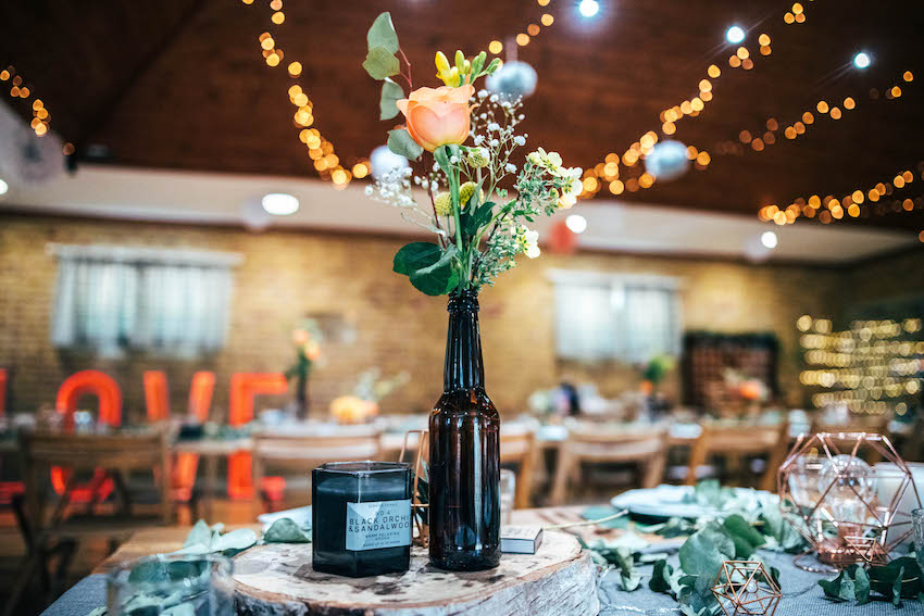Flowers, lights and table decor at wedding