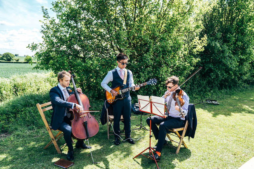 musicians playing during outdoors wedding ceremony