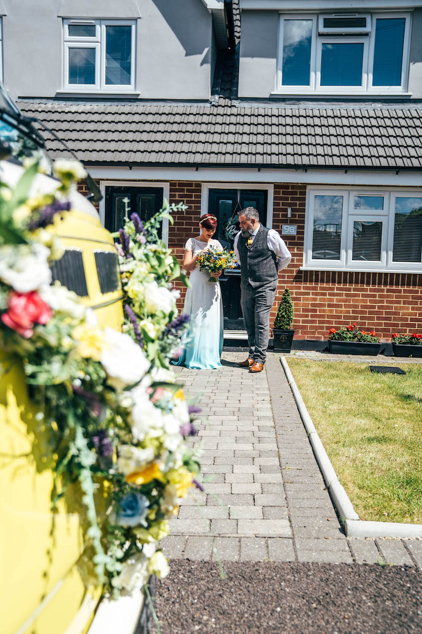 Bride and Father of the Bride leaving house