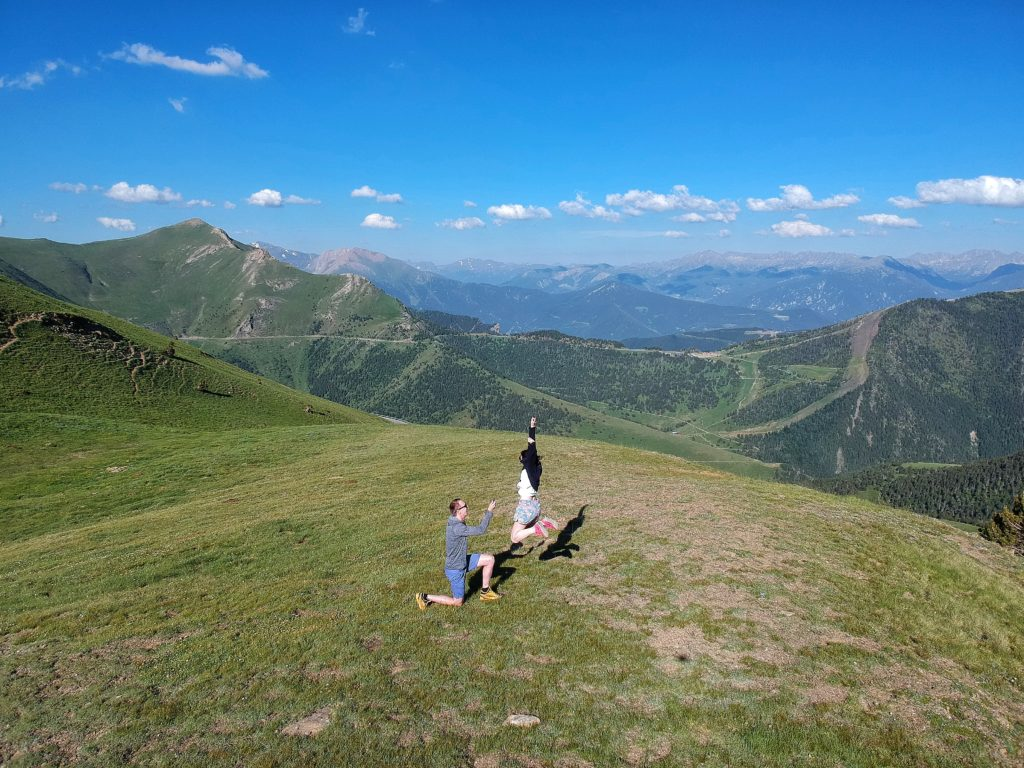 Man proposing to woman on top of mountain