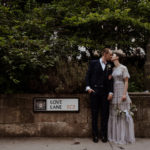 Bride and Groom kissing on London Street Love Lane