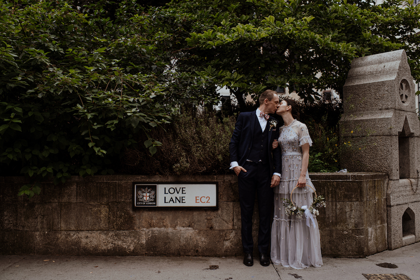 Bride and Groom kissing on London Street Love Lane