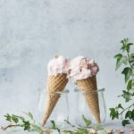 two pink ice creams in glass jars