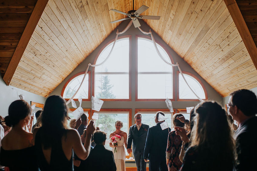 Bride and Groom facing guests after wedding ceremony