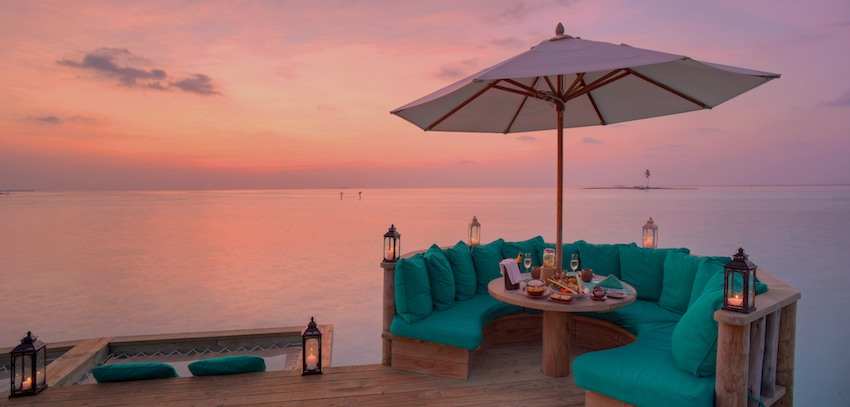 Over water bar at sunset, the Maldives