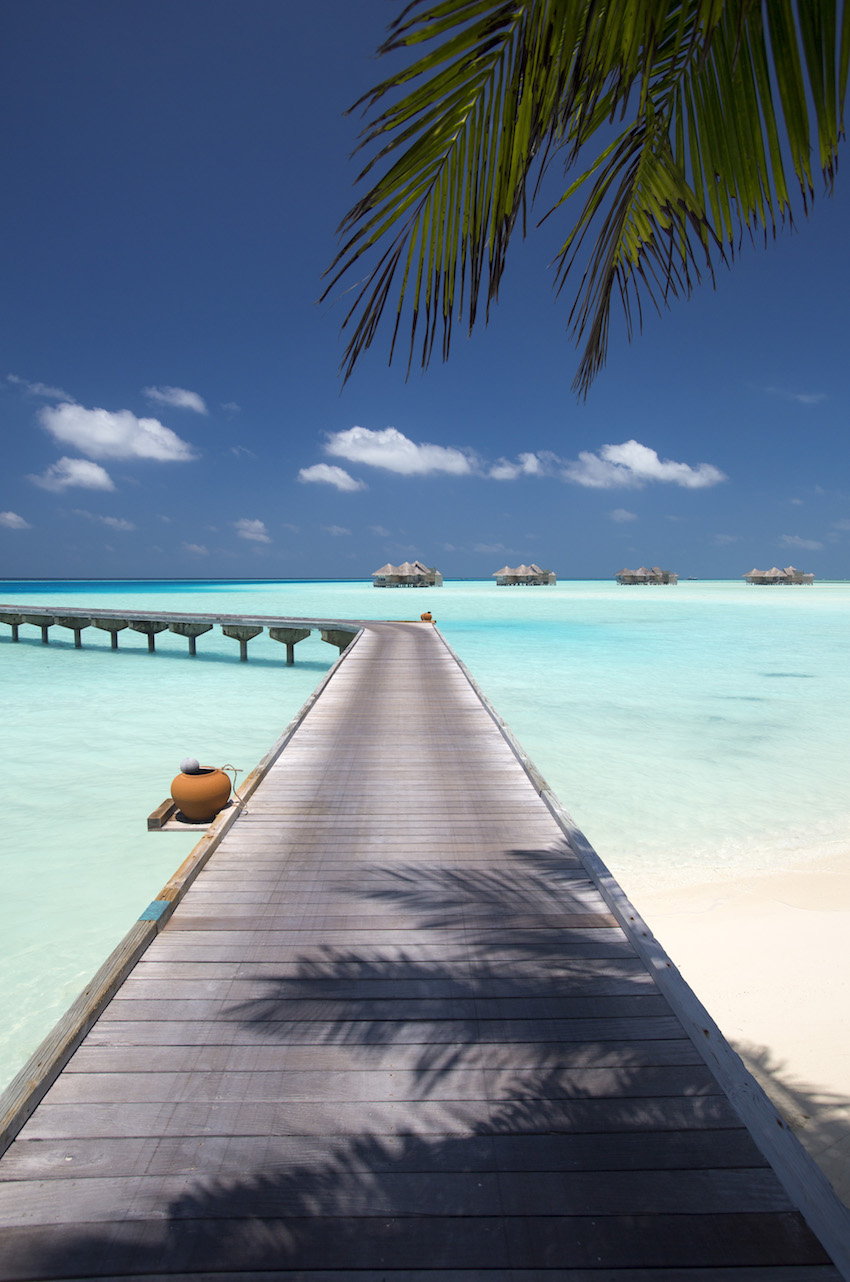Looking out over arrival jetty over turquoise sea, the Maldives