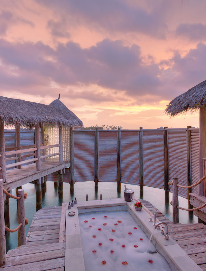 Romantic outdoor jacuzzi on deck of over water villa, the Maldives